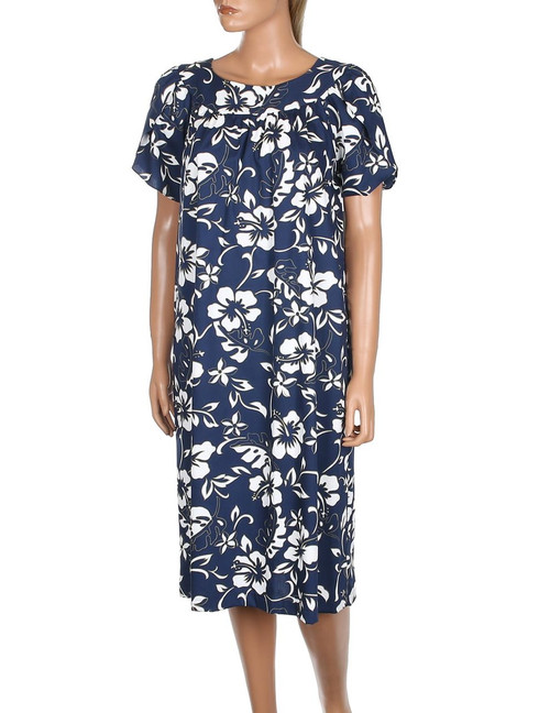 Short Hawaii Muumuu Pull Over Classic Hibiscus Pareo 100% Cotton Fabric Color: Navy Sizes: XS - 3XL Petal Style Sleeves and Round Neckline Comfortable Fit - Pull Over Dress Single Side Pocket Made in Hawaii - USA