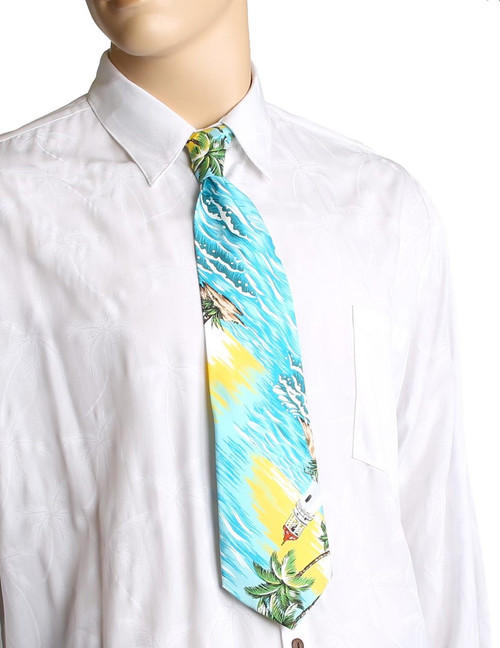"Tropical Aloha Necktie Diamond Head Lighthouse Awesome tropical patterns and colorful designs, perfect for casual and formal events 100% Cotton Fabric Color: Green Length: 53"" Width: 4"" At wide end Made in Hawaii"