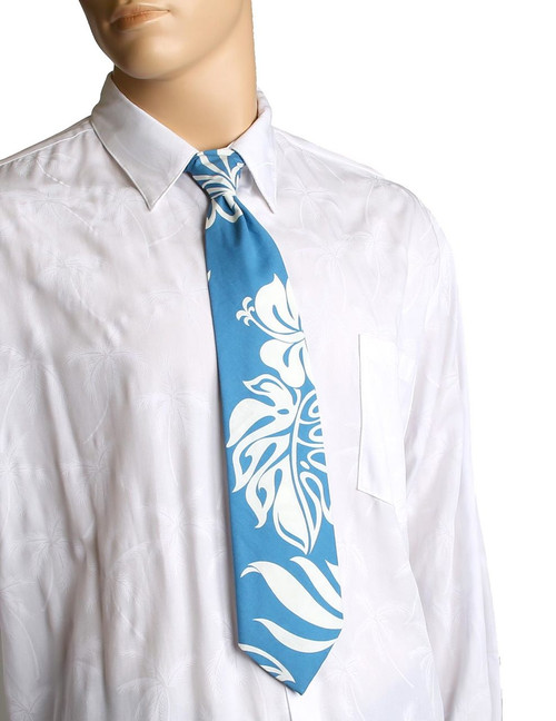 "Tropical Resort Island Blue Necktie Awesome tropical patterns and colorful designs, perfect for casual and formal events 100% Cotton Fabric Color: Ocean Blue Length: 53"" Width: 4"" At wide end Made in Hawaii"