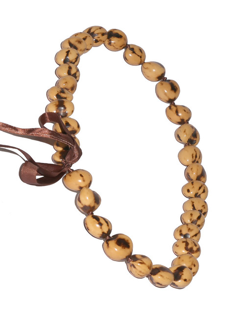 Beige Polished Kukui Nut Candlenut lei Linked Kukui Lei Design Durable - Long-lasting Unscented - Hypoallergenic Color: Beige Length: 38 Inches Circumference Imported Do you need flower accessories for your big event? Ask about quantity discounts.