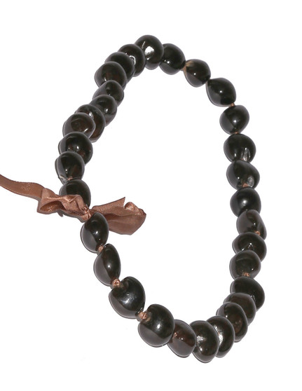 Dark Brown Polished Kukui Nut Candlenut Lei Linked Kukui Lei Design Durable - Long-lasting Unscented - Hypoallergenic Color: Brown Length: 38 Inches Circumference Imported Do you need flower accessories for your big event? Ask about quantity discounts.