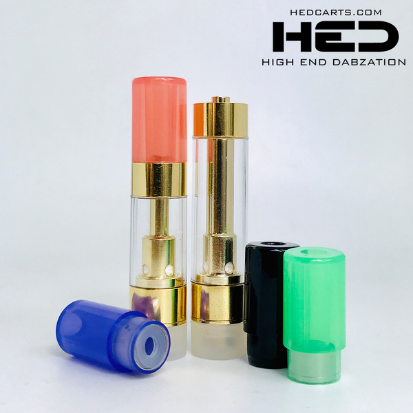 High End Dabzation 0.5mL Gold Pressurized Cartridges with multi color round tips.