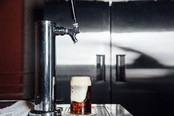 Froth overflowing from beer glass