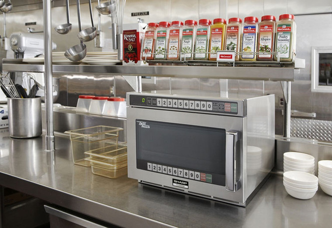 One of Sharp's TwinTouch microwaves sitting on a kitchen counter