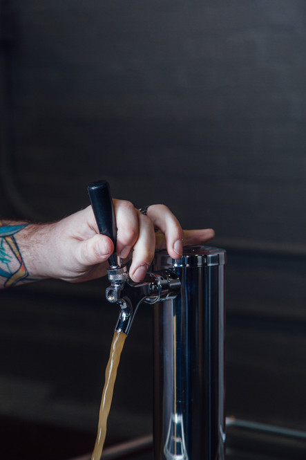 Beer flowing from tap