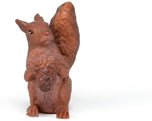 Looking a little inquisitive, or maybe possessive, as the little toy squirrel figurine is not ready to relinquish its treasure!