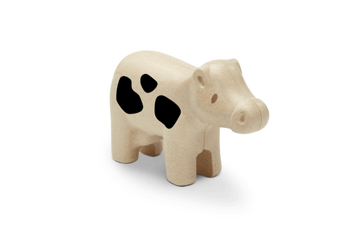 Little cow toy figurine from Plan Toys, made of rubber wood.  For 12 months +
