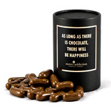 Milk chocolate covered raspberry bullets black cylinder gift box