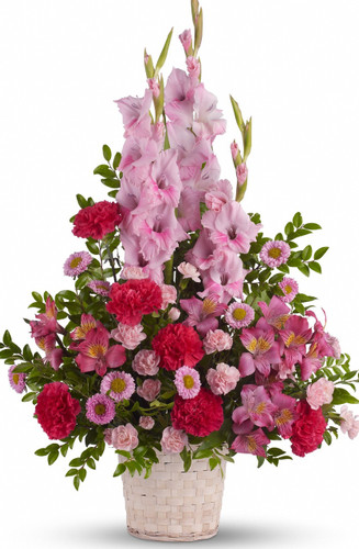 Pink Heavenly Tribute Bouquet by Sympathy Flower Shop. A beautiful mix of fresh pink blossoms like gladioli, alstroemeria, carnations and more are lovingly arranged in a white basket. Your Houston funeral florist. SKU  SYM412