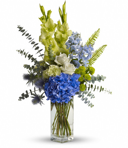 Blue and Green Sympathy Arrangement from Sympathy Flower Shop. Striking blue hydrangea, green roses, carnations and gladioli along with light blue delphinium, blue eryngium, eucalyptus and fern are on wonderful display, when delivered in an elegant clear glass vase. SKU SYM441