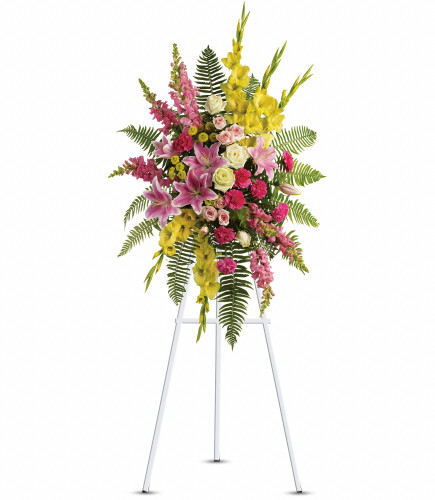 Ray of Sunshine Standing Spray by Sympathy Flower Shop. A lovely combination of flowers such as white roses, yellow gladioli and button spray chrysanthemums, pink spray roses and carnations, light pink stargazer lilies and snapdragons are arranged with a mix of beautiful greenery in a standing spray of flowers that's delivered on a funeral easel. Downtown Houston funeral flower delivery. SKU SYM610