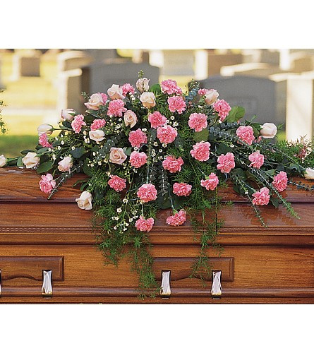 Heavenly Pink Rose and Light Pink Carnation Casket Cover from Sympathy Flower Shop. This medium casket cover spray arrives with pink roses and pink carnations along with distinctive spiral eucalyptus and white Monte Cassino asters. SKU SYM820