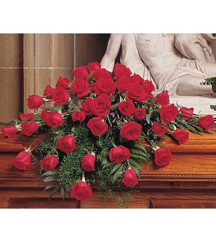 Small Red Rose Casket Cover Spray from Sympathy Flower Shop. Our classic casket spray arrives with forty-eight red roses arranged to gently fit on the caskets lid.  SKU SYM820