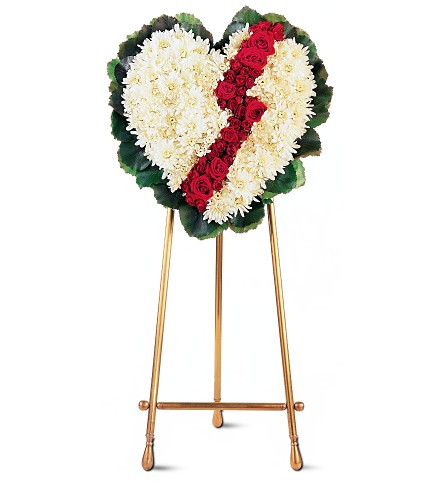 """My Broken Heart Red Rose Sympathy Spray from Sympathy Flower Shop. This unique heart-shaped design arrives covered with white chrysanthemums, accented with a break of red roses and red spray roses. The heart is delivered on an easel. Approximately 21"""" W x 24"""" H SKU SYM105"""
