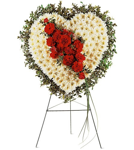 "Bleeding Heart of Sorrow Funeral Flowers from Sympathy Flower Shop. This solid heart is covered with white chrysanthemums, accented with a cluster of red carnations and red mini pixie carnations and edged in oregonia. The heart is delivered on an easel. Approximately 21"" W x 23"" H  SKU SYM106"