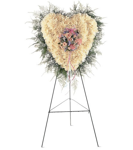 "Heavenly Soul Heart Shaped Funeral Flowers from Sympathy Flower Shop.This solid-flower heart arrives on an easel covered in white carnations and the center decorated with pink, white and blue flowers mounted in the center. Approximately 20"" W x 22"" H SKU SYM108"
