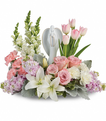 "Hopeful Gardens White Angel Keepsake with Pink Funeral Flowers from Sympathy Flower Shop. This lovely arrangement of light pink roses, light pink tulips, white lilies, light pink carnations, white carnations, white snapdragons and light pink stock is accented with variegated pittosporum. Bouquet size is approximately 20"" W x 16"" H SKU SYM461"