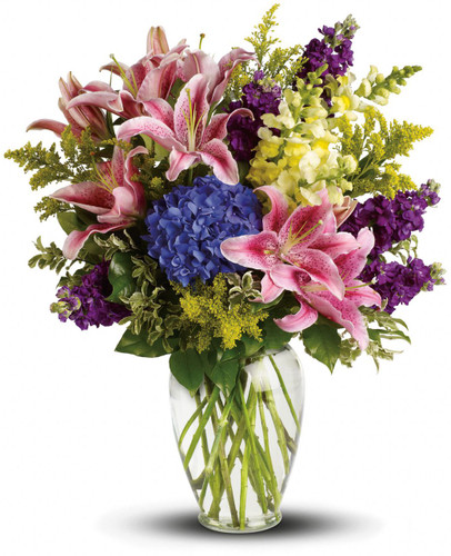 Everlasting Love Sympathy Arrangement by Sympathy Flower Shop. Put your words of caring into flowers with this beautiful array of pink lilies, blue hydrangea and other floral favorites in a sparkling urn. SKU SYM436