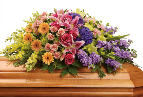 Sweet Memories Stargazer & Purple Hydrangea Casket Cover from Sympathy Flower Shop. This elegant bouquet includes purple hydrangeas, hot pink roses, peach spray roses, pink stargazer lilies, peach miniature gerberas, green gladioli, pink carnations, yellow snapdragons, lavender stock and is accented with assorted greenery foliages.  SKU SYM810