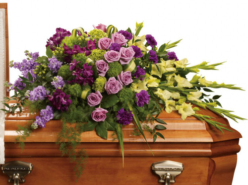 Reflections Lavender Rose & Purple Flower Casket Cover from Sympathy Flower Shop. This lush arrangement includes green miniature hydrangeas, lavender roses, purple alstroemeria, green gladioli, green trick dianthus, purple carnations, lavender stock and green hypericum, and is accented with assorted greenery foliages.  SKU SYM809
