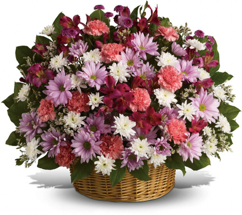 My Reflections Funeral Basket by Sympathy Flower Shop. Beautiful flowers such as pink carnations and alstroemeria, lavender button and daisy spray chrysanthemums along with white cushion spray chrysanthemums and more fill a lovely round wicker basket. SKU SYM426