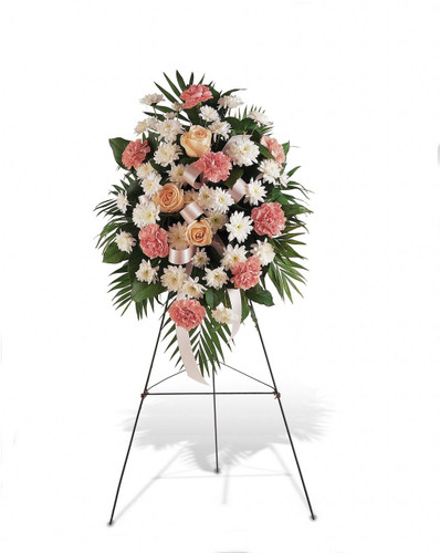 Our Gentle Thoughts Spray from Sympathy Flower Shop. This standing spray includes pink carnations, white chrysanthemums and rose accents with a pink ribbon is delivered on a funeral easel. SYM601