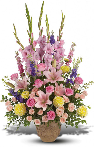 Pink Ever Upward Urn by Sympathy Flower Shop. This lovely bouquet includes hot pink roses, light pink spray roses, pink lilies, pink gladiolas, pink larkspur, and purple larkspur in a lovely ceramic container. A Houston funeral flower delivery. SKU SYM403