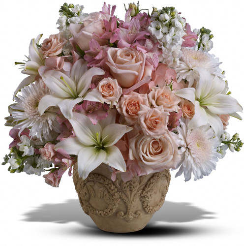 Pink Garden of Memories by Sympathy Flower Shop. This lovely bouquet includes pink hydrangeas, pink roses, pink spray roses, white lilies, pink alstromeria, white stock and white cremons. Your Houston funeral florist. SKU SYM409