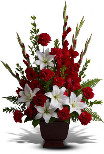 Tender Memories Funeral Arrangement by Sympathy Flower Shop. Beautiful fresh flowers of red gladiolas and carnations with white lilies set amidst myrtle, sword fern, and salal in a classic urn. Your top Houston funeral florist. SKU  SYM419