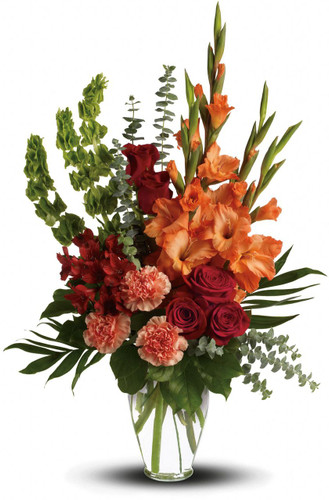 "Sunshine Memories Funeral Flowers by Sympathy Flower Shop. Red roses, red alstroemeria and orange gladioli - a lovely tribute that sends a message of healing and hope for those mourning their loss. The brilliant arrangement includes red roses, red alstroemeria, orange gladioli, orange carnations and bells of Ireland, accented with assorted greenery. Approximately 20"" W x 26 1/2"" H SKU SYM439"