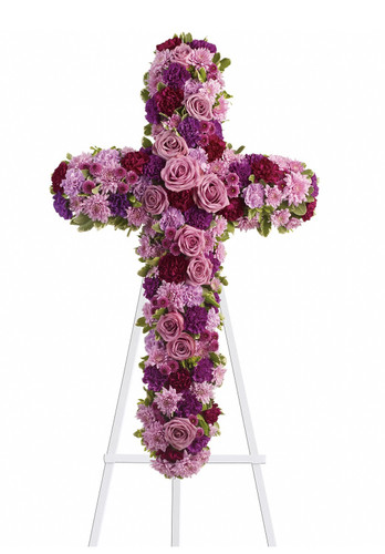 "Purple and Lavender Rose Funeral Flower Cross from Sympathy Flower Shop. Beautiful flowers such as lavender roses, carnations and mums along with fuchsia and purple carnations and button mums create a dazzling cross that is full of hope and devotion, arriving on a wire funeral easel. Approximately 23"" W x 38"" H SKU SYM301"