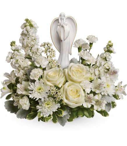 "Pure White Flowers and Angel Keepsake Sympathy Arrangement from Sympathy Flower Shop. White roses, white alstroemeria, white stock, white miniature carnations, white cushion spray chrysanthemums are arranged with white waxflower, and variegated pittosporum. Delivered with an Angel of Grace keepsake.  Bouquet size is approximately 16"" W x 14"" H  SYM459"