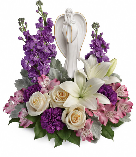 "Purple Flowers with Beautiful White Angel Keepsake Bouquet from Sympathy Flower Shop.This royal arrangement includes crème roses, white lilies, lavender alstroemeria, purple carnations, lavender stock, and lemon leaf. Bouquet size is approximately 14"" W x 14"" H SKU SYM449"