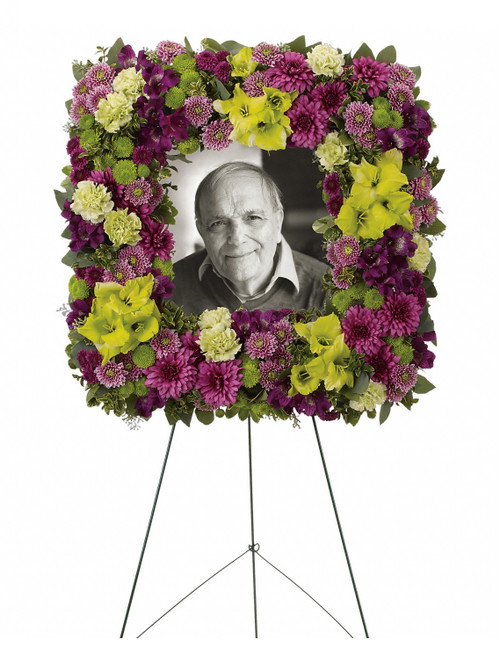 """Mosaic Memories Square Photo Tribute Funeral Spray from Sympathy Flower Shop. The elegant standing spray includes purple alstroemeria, green gladioli, green carnations, purple cushions, lavender buttons, green buttons and purple buttons, accented with assorted greenery. Approximately 23"""" W x 23"""" H  SKU SYM209"""
