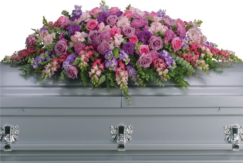 Lavender and Pink Rose Tribute Casket Spray from Sympathy Flower Shop. This casket cover includes lovely lavender and pink roses, snapdragons, alstroemeria, chrysanthemums, larkspur and assorted greenerys to create this tribute that is overflowing with grace and love. SKU SYM803
