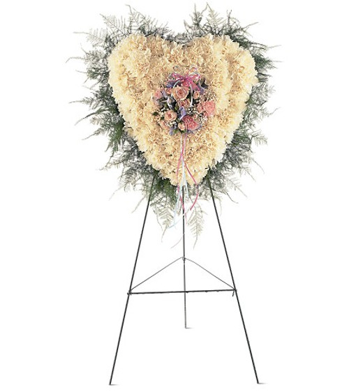 """Heavenly Soul Heart Shaped Funeral Flowers from Sympathy Flower Shop.This solid-flower heart arrives on an easel covered in white carnations and the center decorated with pink, white and blue flowers mounted in the center. Approximately 20"""" W x 22"""" H SKU SYM108"""