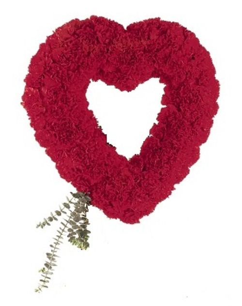 """Forever Loved Heart Shaped Red Carnation Sympathy Spray from Sympathy Flower Shop. An open-center heart arrives on an easel covered with red carnations accented with eucalyptus. Heart is approximately 21"""" W x 28"""" H SKU SYM109"""