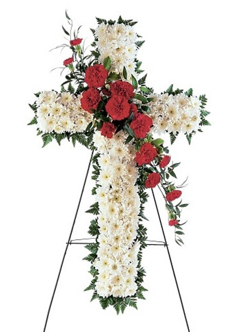 "Red Carnation Funeral Flower Cross from Sympathy Flower Shop. The funeral spray includes the sympathy cross covered in  white chrysanthemum flowers with a cluster of red carnations through the center and arrives on a funeral easel. Approximately 22"" W x 34"" H  SKU SYM305"