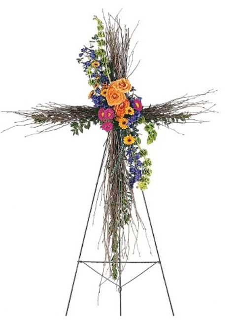 "Compassionate Care Birch Funeral Cross of Bright Flowers from Sympathy Flower Shop. The natural birch cross on an easel arrives with a cluster of vibrant fresh flowers including hot pink asters, orange roses and blue delphinium. Approximately 32"" W x 50"" H SKU SYM307"