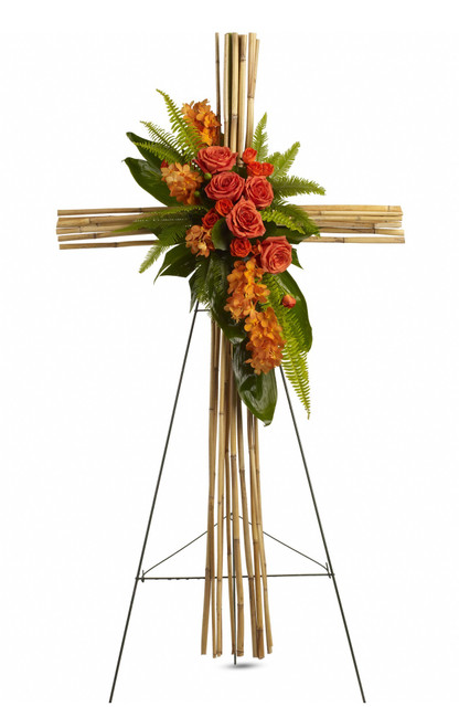 """Orange Roses River Cane Sympathy Flower Cross from Sympathy Flower Shop. This natural river cane cross is adorned with a brilliant display of flowers and greenery, such as orange mokara orchids, orange roses and spray roses, green ti leaves, umbrella and sword fern and galax leaves, all in an arrangement that is as exceptional as it is beautiful. Approximately 28"""" W x 50"""" H  SKU SYM308"""