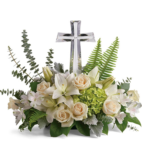 """Glorious Love Large Crystal Cross with All White Funeral Flowers from Sympathy Flower Shop. Your funeral flowers will arrive with green hydrangea, crème roses, white lilies, white alstroemeria are accented with sword fern, spiral eucalyptus, and lemon leaf. Funeral flowers are approximately 22"""" W x 18"""" H. SKU SYM450"""