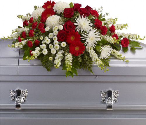 Small Red and White Casket Cover Spray from Sympathy Flower Shop. This half casket spray includes dazzling red roses and gerberas, brilliant white mums and larkspur are arranged with gentle green foliages to create a strong yet soothing arrangement.  SKU SYM816