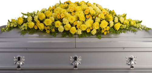 Sunshine Yellow Rose Casket Cover from Sympathy Flower Shop. Sunny yellow roses, spray roses, carnations, chrysanthemums, snapdragons and more are arranged in a dazzling full funeral casket spray. SKU SYM813