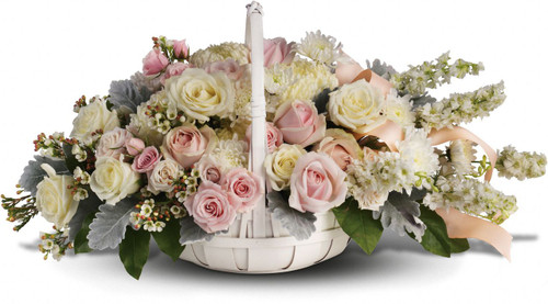 Pink Remembrance Funeral Basket by Sympathy Flower Shop.  Elegant blooms of white and light pink roses with white larkspur, white mums and silvery dusty miller in a white wicker basket. Your Pearland funeral florist. SKU SYM421