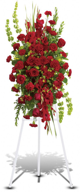 Compassionate Care Standing Spray by Sympathy Flower Shop.  Classic flowers such as red roses, gladioli and carnations along with bells of Ireland and other simple greenery create a spray that is both memorable and loving. Pearland funeral flower delivery. SKU SYM604