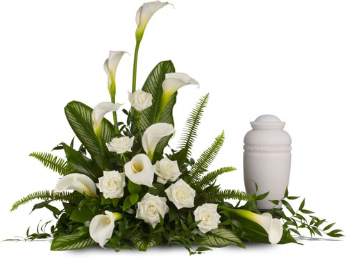 "Stately White Calla Lilies by Sympathy Flower Shop. A calming portrait in ivory. Majestic calla lilies and stately white roses are framed by the lush leaves of aspidistra and calathea. Soft green sword fern adds to the soothing tones. Approximately 40""w x 31""h.  SKU SYM001"