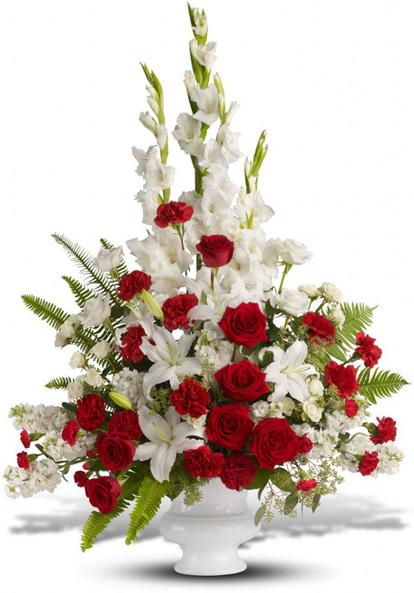 Treasured Memories Funeral Arrangement by Sympathy Flower Shop.  A mix of fresh flowers such as red and white roses, oriental lilies, graceful gladioli, carnations and fragrant eucalyptus. Beautifully presented in a white urn. The best funeral florist in Houston TX. SKU  SYM414