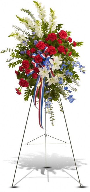 Sacred Heart Standing Spray from Sympathy Flower Shop. This gorgeous selection of flowers such as white oriental lilies and snapdragons, blue delphinium, red carnations and miniature carnations, eucalyptus and more create this all-American spray. Free League City funeral flower delivery.  SKU SYM607
