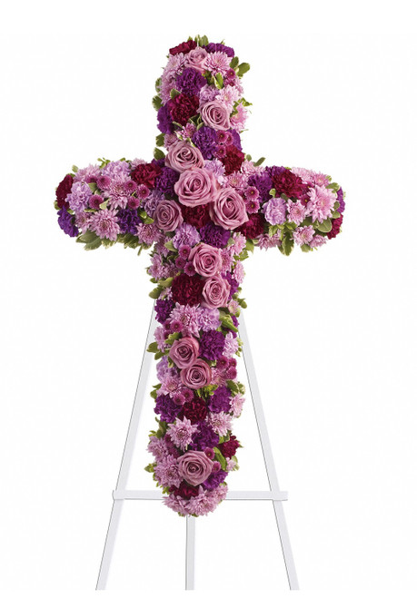 """Purple and Lavender Rose Funeral Flower Cross from Sympathy Flower Shop. Beautiful flowers such as lavender roses, carnations and mums along with fuchsia and purple carnations and button mums create a dazzling cross that is full of hope and devotion, arriving on a wire funeral easel. Approximately 23"""" W x 38"""" H SKU SYM301"""