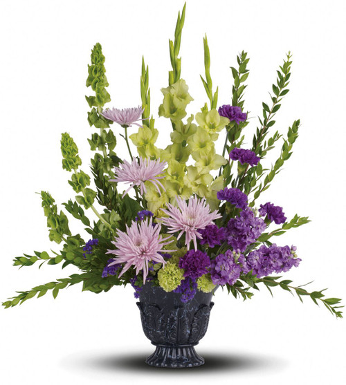 Cherished Love Funeral Flowers by Sympathy Flower Shop. This ethereally lovely bouquet of green gladioli, lavender stock, purple carnations and more in a timeless-tribute urn is a stunning choice for the memorial service. The elegantly beautiful bouquet includes green gladioli, lavender stock, green carnations, purple carnations, lavender spider chrysanthemums, bells of Ireland and purple sinuata statice. SKU SYM438